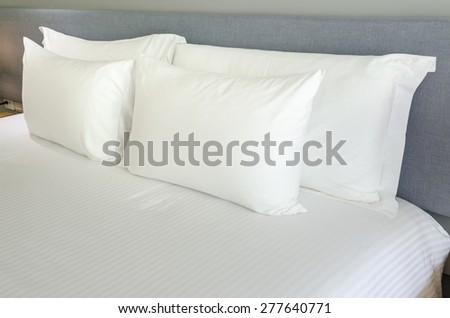 White pillows on a bed Comfortable soft pillows on the bed. - stock photo