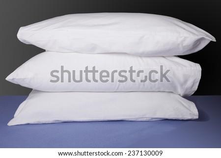 White pillows on dark background - stock photo