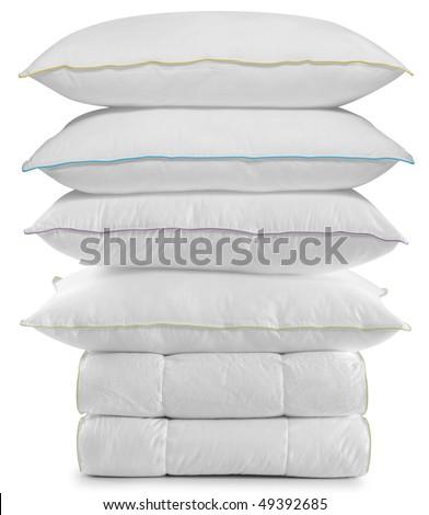White pillows on duvet. Isolated - stock photo