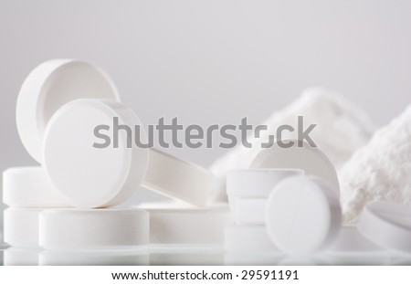 white pills closeup - stock photo