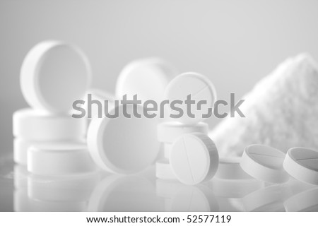 white pills closeup - stock photo