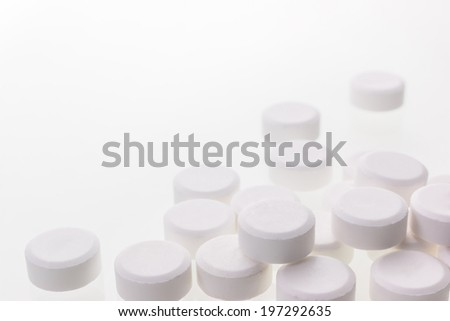 White pills isolated over white