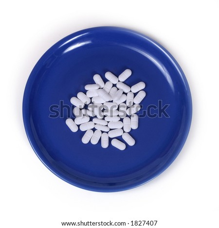 white pills on a blue plate