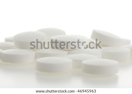 white pills on white