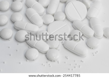 White pills / tablets / medicine - stock photo