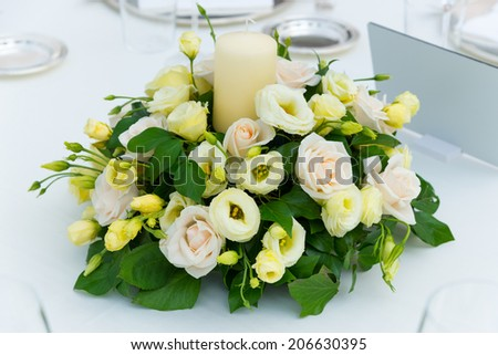 white pink and yellow roses flowers on table for a wedding - stock photo