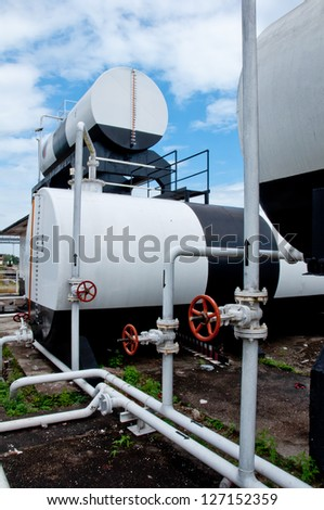 White pipeline and tank with valve - stock photo