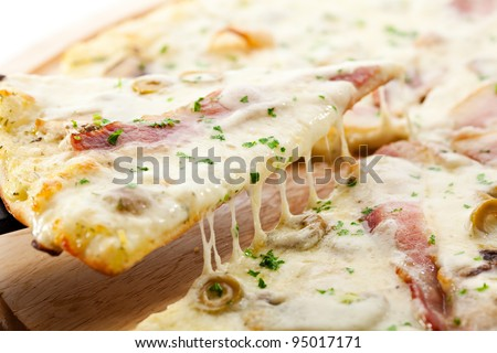 White Pizza made from Sour Cream Sauce, Mushrooms, Ham and Mozzarella Cheese - stock photo