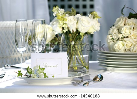 White place card on outdoor wedding table - stock photo
