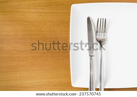 White place setting on a  wooden table - stock photo