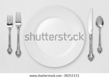 White Place Setting on tablecloth with a clipping path - stock photo