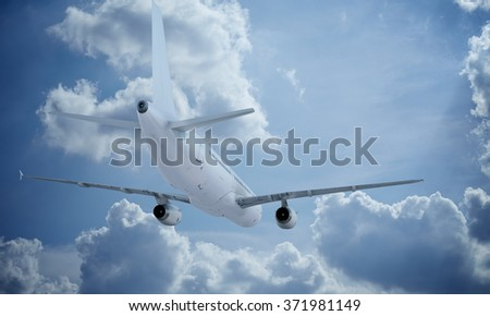 White plane flying in sky and clouds. Passenger airplane airbus a321. - stock photo