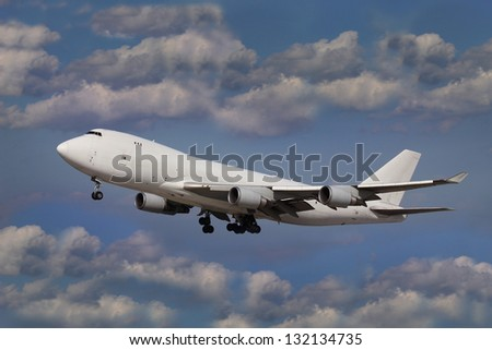 White plane in the blue sky with clouds - stock photo