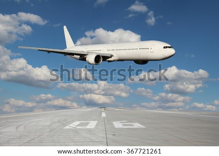 White plane makes a low pass over the airport runway