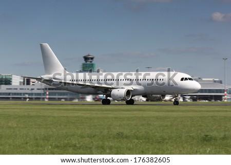 White plane take off - stock photo