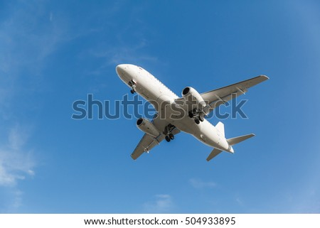 white plane takes off