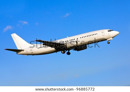 white plane with the gear against the blue sky - stock photo