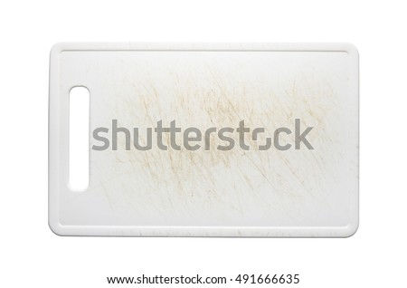 White plastic chopping board with stains from use, isolated on white background with clipping path