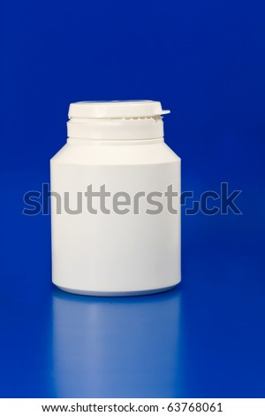 white plastic medicine container isolated on blue background - stock photo