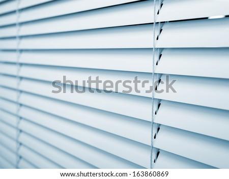 White plastic window blinds close studio shot - stock photo