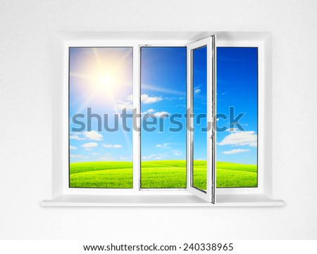 White plastic window isolated on white background and view on field - stock photo