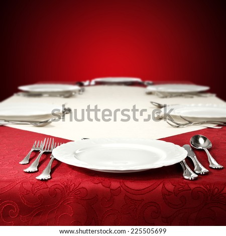 white plate and red table of red wall in xmas time  - stock photo