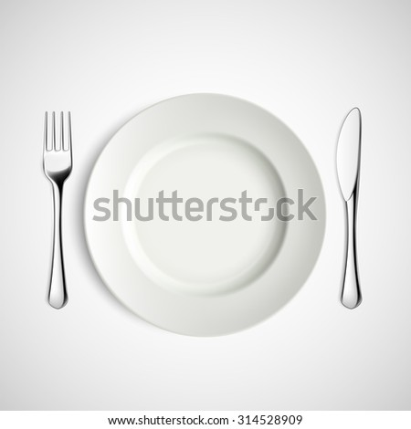 White plate, fork and knife. Stock image. - stock photo