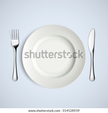 White plate, fork and knife. Stock image.
