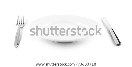 white plate, knife and fork cutlery isolated with clipping paths included - stock photo