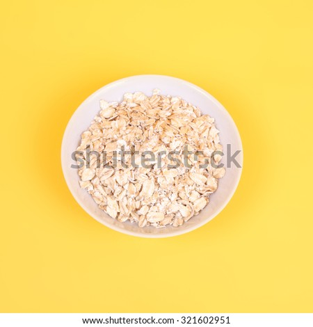 white plate of oats closeup - stock photo