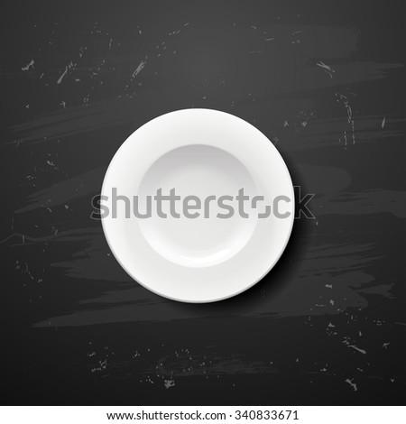 white plate on blackboard.bitmap version - stock photo