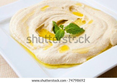 white plate with fresh hummus libanese food - stock photo