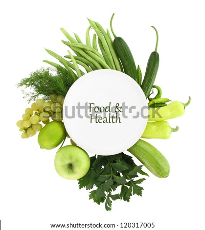 White plate with green food around it - stock photo