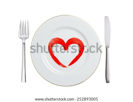 white plate with paint red heart symbol, spoon and fork isolated on white