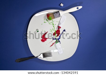 White plate with paint strokes instead of food - stock photo