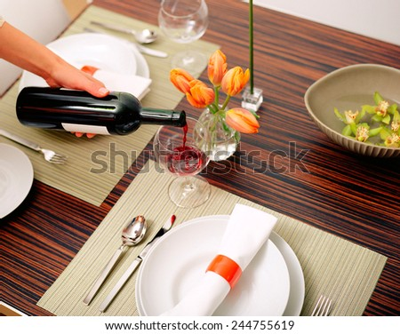 white plate with red wine - stock photo