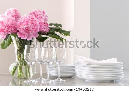 white plates & napkins, wine glasses & peonies - home entertainment - stock photo
