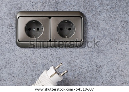 White plug and a power socket - stock photo