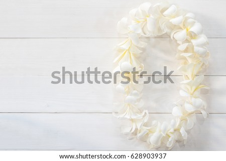 White plumeria flower lei garland flat stock photo 628903937 white plumeria flower lei garland flat lay on natural white pine wood background for hawaii lei mightylinksfo Images