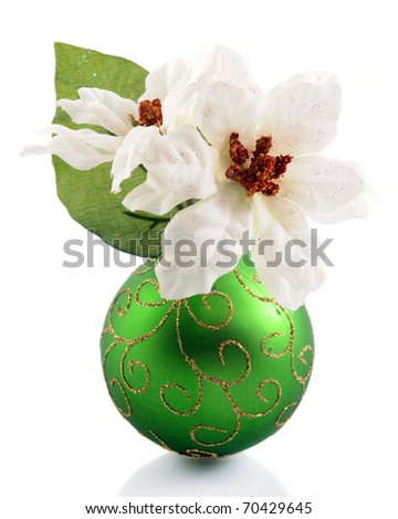White poinsettias in a green Christmas bulb with sparkly gold swirls.  Isolated on white. - stock photo