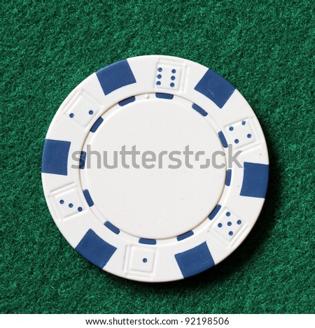 white poker chip on a table - stock photo