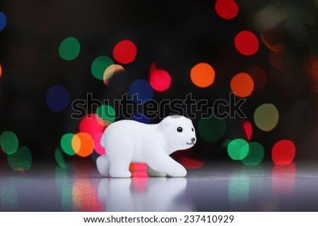 White polar bear toy close up on a bokeh background - stock photo