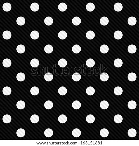White Polka Dots on Black Textured Fabric Background that is seamless and repeats - stock photo