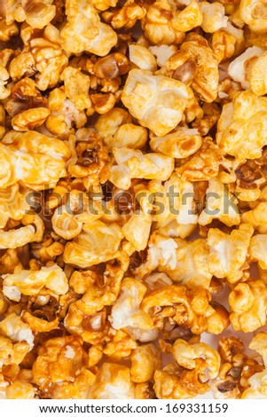 White pop corn texture with caramel, food image - stock photo