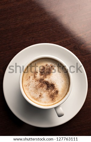 White porcelain cup od cappuccino coffee - stock photo