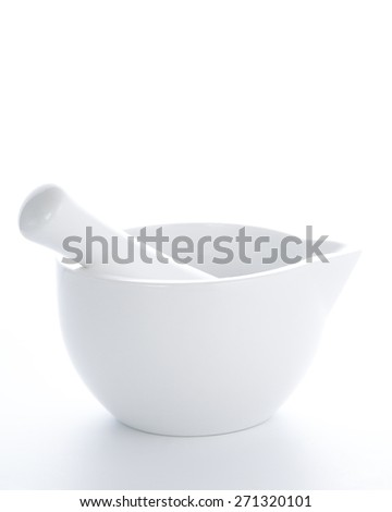 white porcelain mortar and pestle set isolated on white background - stock photo