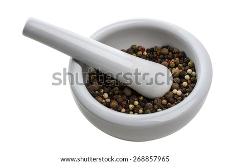 white porcelain mortar and pestle set with mix of pepper seeds isolated on white background - stock photo
