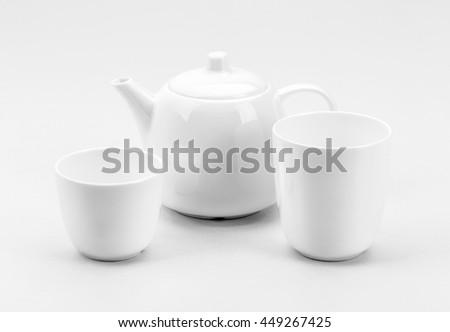 White porcelain tea set on white background - stock photo
