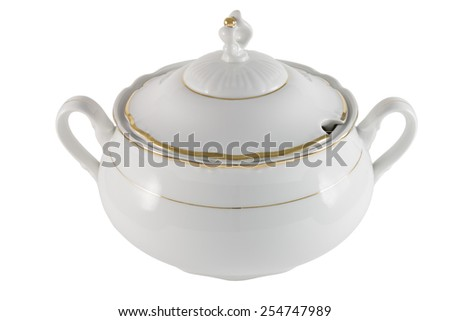 White porcelain tureen with lid and gold border on a white background