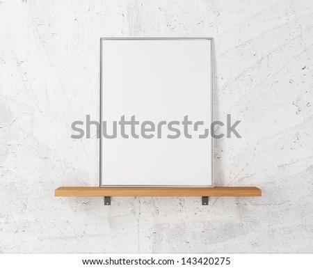 white poster on a shelf - stock photo